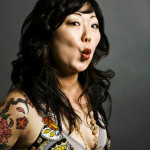 "Margaret Cho <br/> <img src=""http://www.shaitayeb.com/wp-content/uploads/2015/11/usa-flag.png"">"